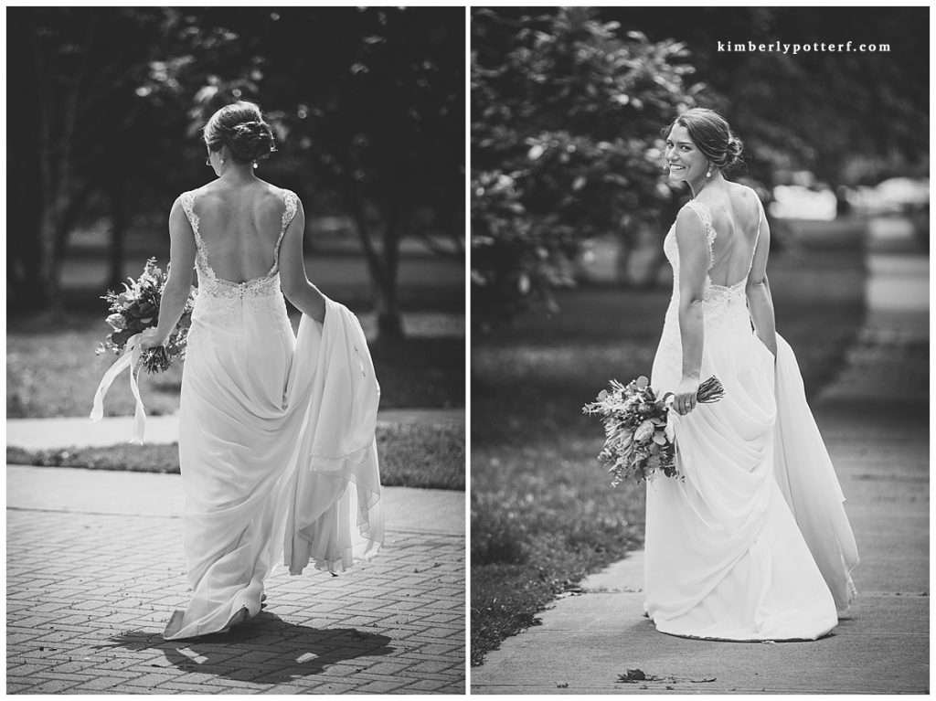 rear view of a bride walking away from the camera and wearing a low back wedding gown