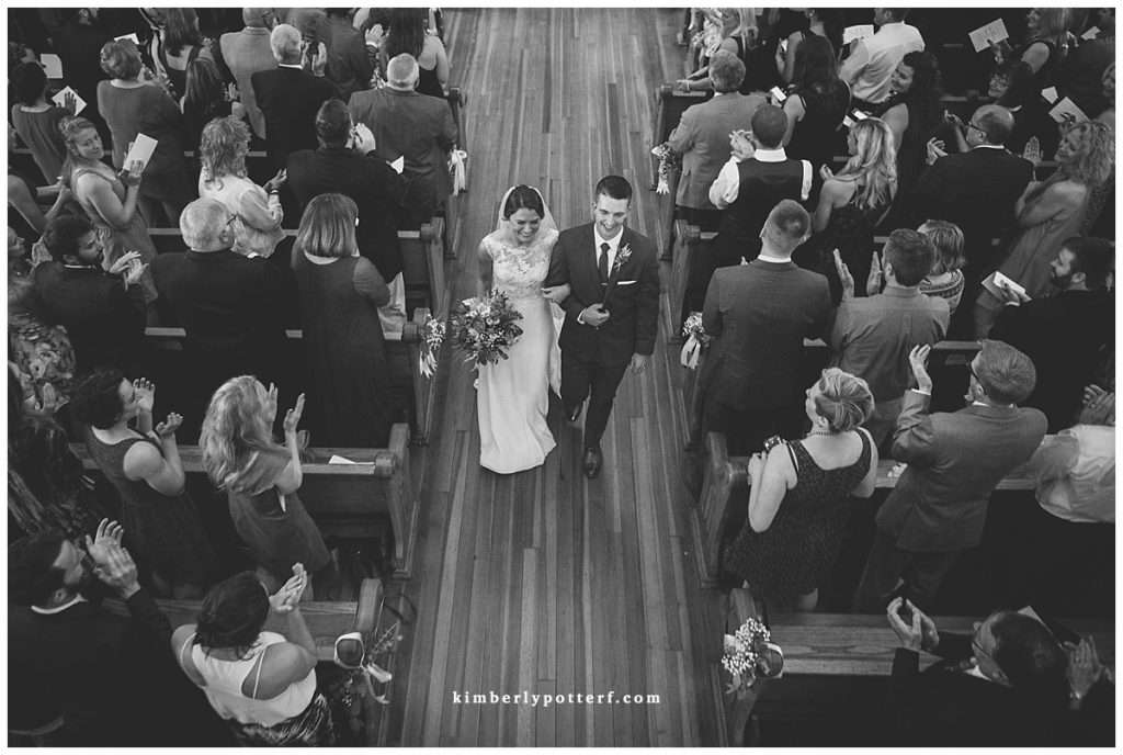 Overhead view of a newly married bride and groom exiting their church