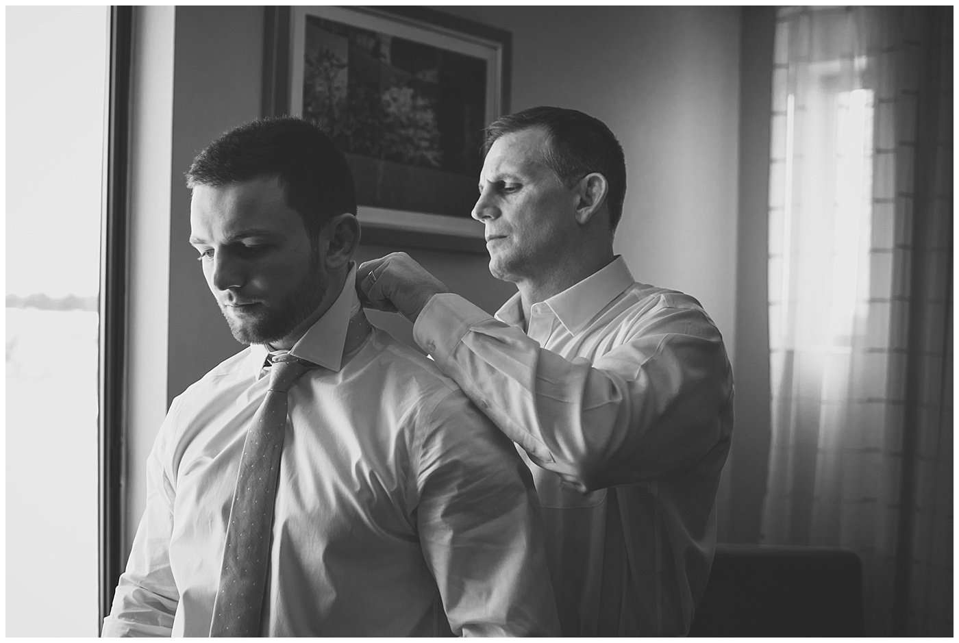 a groom getting ready with his father on his wedding day