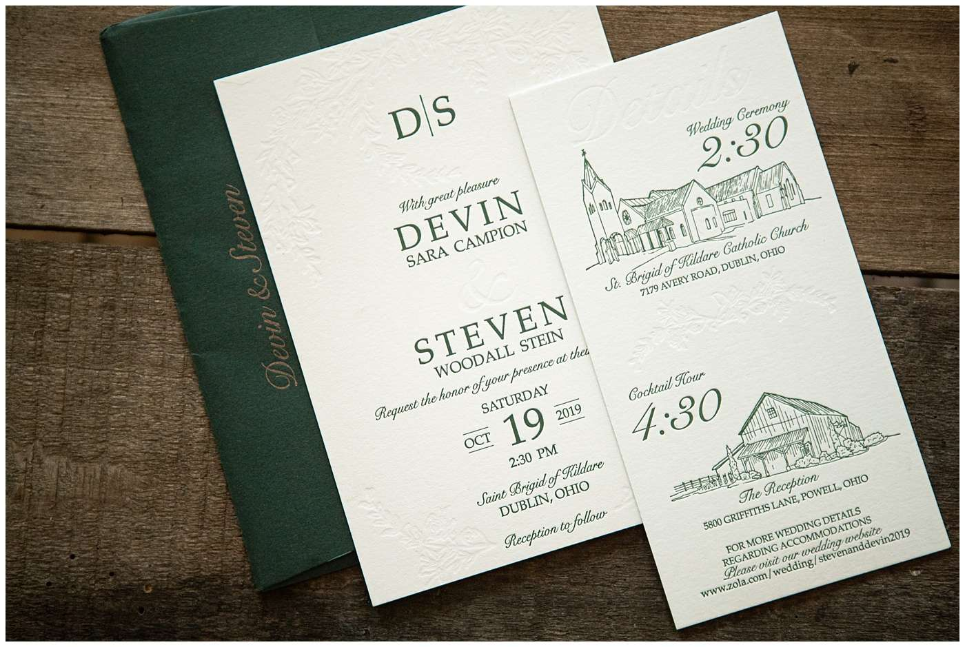 letterpress wedding invitations laying on a backdrop of barn wood